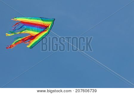 big colored kite flying high in the sky symbol of freedom and joy