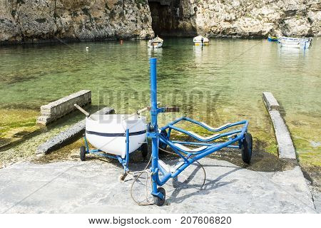 Boat on the trolley for launching on the water. The Inland Sea is a lagoon of seawater on the island of Gozo linked to the Mediterranean Sea through a narrow natural arch.