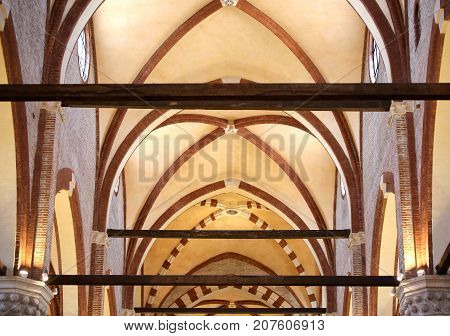 Vaulted Ceiling Of A Church With Beams