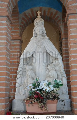 statue of our Lady with the faithful under his protective cloak