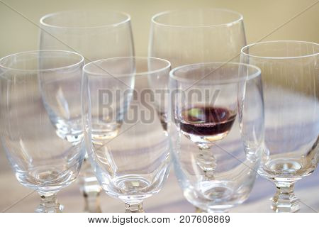 pouring red wine in crysta glass to sip