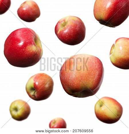 Falling red and yellow apples on white background isolated