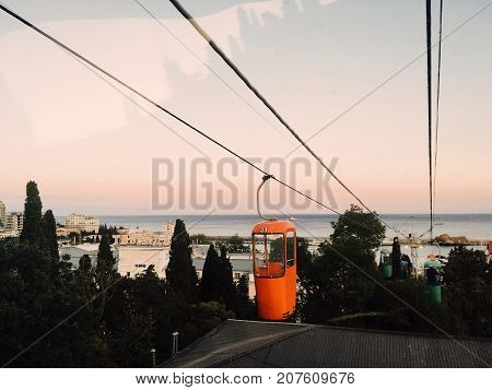 ropeway in city Yalta on roof of houses