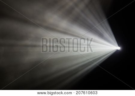 Rays theatrical spotlights on the stage during the performance. Lighting equipment. The lighting designer. Theatre arts