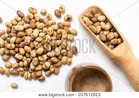 Flat Lay Above Soya Beans With Wooden Spoon Above White Marble Background