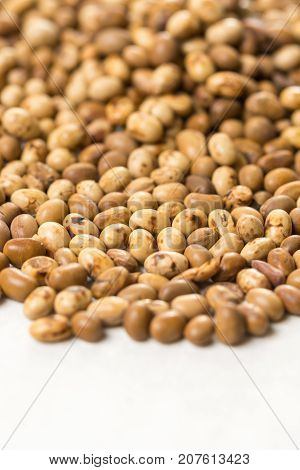 Selective Focus On Pile Of Soya Beans On The White Marble Background