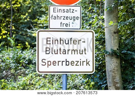 DUESSELDORF , GERMANY - OCTOBER 05 2017: Sign warning of of the infectious equine anaemia EIA . Translation: Equine anemia prohibited area