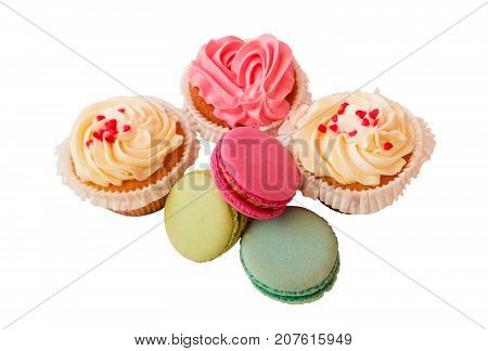 Macaroons and cupcakes isolated on white background. Selective focus.