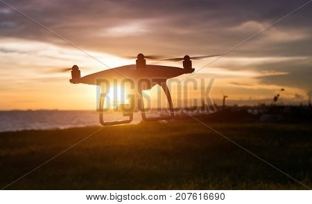 Silhouette Of Flying Drone In Sunset Time.