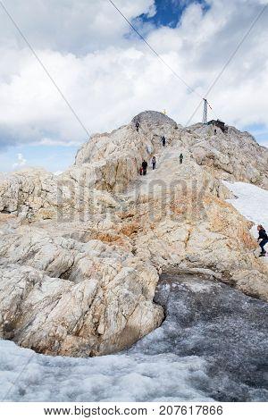 Ramsau Am Dachstein, Austria - August 17: People Hiking On Gjaidstein Mountain Adventure Trail Near