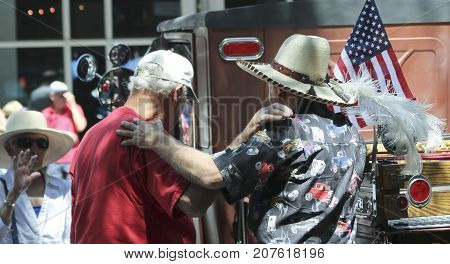 SANTA FE, NEW MEXICO, JULY 4. The Plaza on July 4, 2017, in Santa Fe, New Mexico. A Trio of Old Friends Reunite at a Vintage Car Show a Tradition on the Fourth of July in Santa Fe New Mexico.
