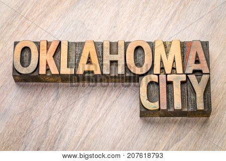 Oklahoma City word abstract in vintage  letterpress wood type against grained wooden background