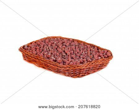Red adzuki beans in wooden basket also called azuki aduki or Red Mung Bean. Dried small beans of Vigna angularis. Isolated macro food photo close up on white background