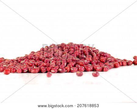 Red adzuki beans also called azuki aduki or Red Mung Bean. Dried small beans of Vigna angularis. Isolated macro food photo close up on white background