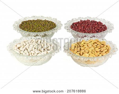 Mixed beans and in the glass bowl on white background. mung bean red kidney bean yellow bean red bean green beanmillet.