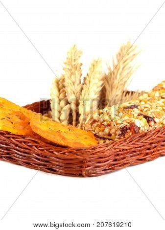 grain crackers biscuits and grains of wheat on white background