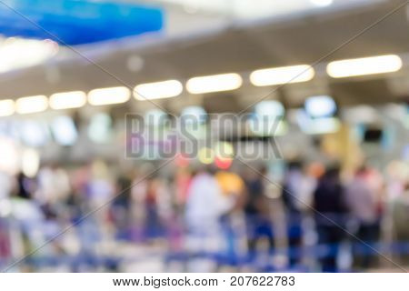 Blurry Of People Who Are Waiting For Queues To Check In At The Airport
