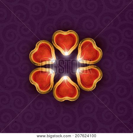 Stock photo of diwali greeting card showing illuminated diya or oil lamp or panti with copyspace