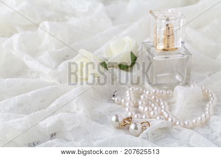 Wedding Lace Garter And Perfume Waiting Bride. Selective Focus.
