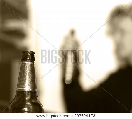 bottle of beer on background, beer drinker