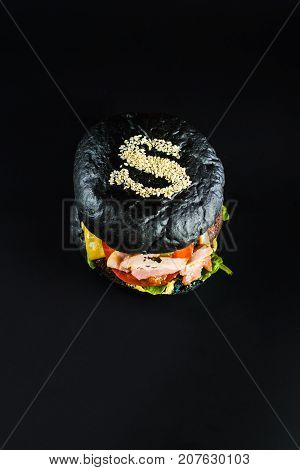 Black Craft Burger With Cheese And Bacon. Craft Burger With Black Bun On Dark Background