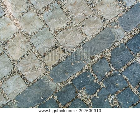 Dark And Light Gray Granite Stone Pavement Texture, Abstract Cobblestone Pavement Close-up.