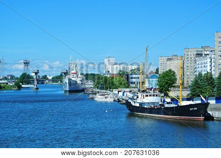 KALININGRAD RUSSIA - JUNE 14 2017: A view to a city embankment and ships at the exibition of the Museum of World Ocean.