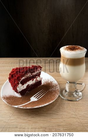 Very Tasty And Appetizing Burgundy Velvet Cake With A Cup Of Cappuccino
