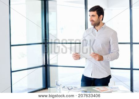 Young caucasian businessman standing in office