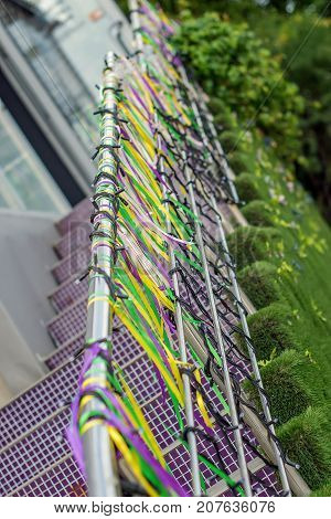 Multicolored ribbons on the railing at the entrance