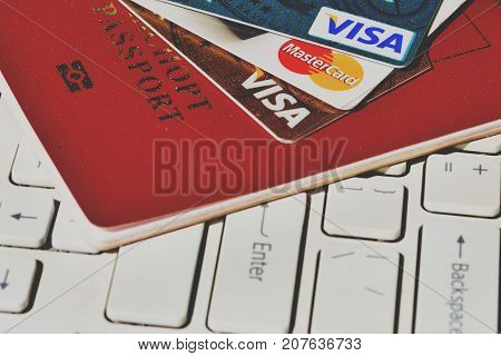 Concept Money with Journey Travel credit card passport and travel itinerary. of plastic cards Visa and Mastercard