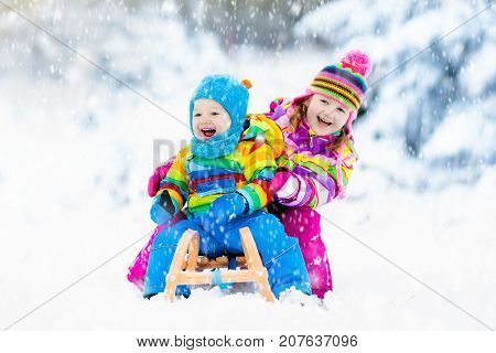 Kids On Sleigh Ride. Children Sledding. Winter Snow Fun.