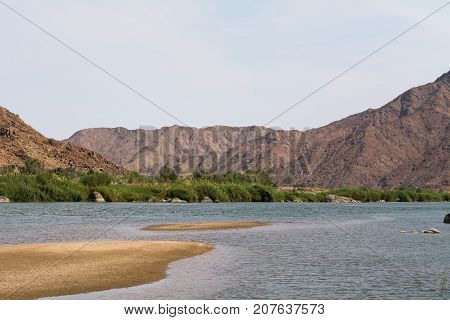 view on the oranje river in namibia, africa. the oranje river is the longest river in south africa and builds the border of namibia and south africa.
