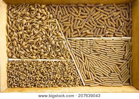 Wooden Tray With Assorted Whole Wheat Pasta