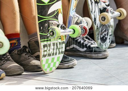 Dordrecht Netherlands - 3 September 2016: Skateboarders wheels and feet as teens hang out at the official opening of the new skateboard park in Dordrecht.