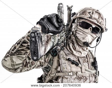 Half length low angle studio shot of special forces soldier in field uniforms and face mask with sniper rifle on his shoulder, portrait isolated on white background