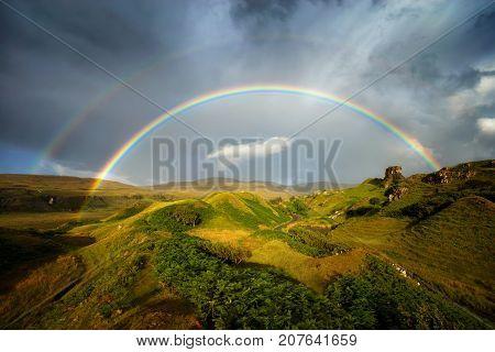 Rainbow over Fairy Glen hills Isle of Skye Scotland