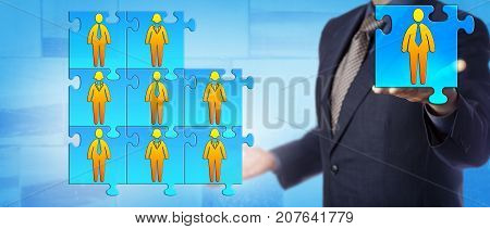 Unrecognizable male business director is offering the final piece to complete his work team puzzle. Human resources concept for team building collaboration cooperation and succession planning.
