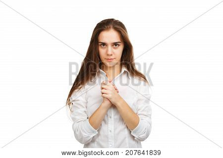 Pretty young girl with folded arms near the chest. In a white blouse, and with her hair extruded. Isolated on white background.