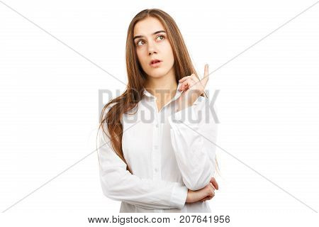 Close-up portrait of a young beautiful girl in a white blouse with long flowing hair. Which was visited by a new idea. Isolated on white background.
