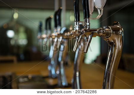 Beer taps in row at restaurant