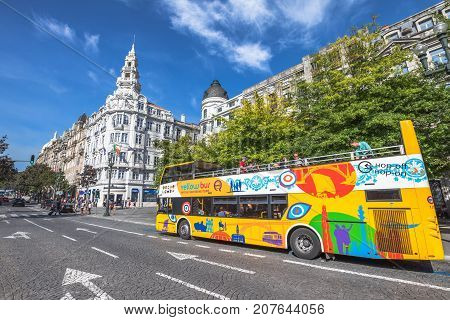 Porto, Portugal - August 11, 2017: Yellow Bus Tours Oporto, the leading tour operator in panoramic buses in Portugal, Praca da Liberdade or Freedom Square in Avenidas dos Alidaos in a sunny day.