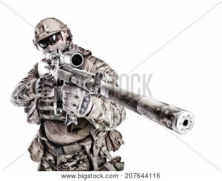 Half length low angle studio shot of big muscular soldier in field uniforms with sniper rifle, portrait isolated on white background lot of copyspace. Protective goggles glasses are on