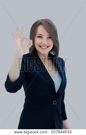 Portrait of happy smiling young cheerful businesswoman, showing