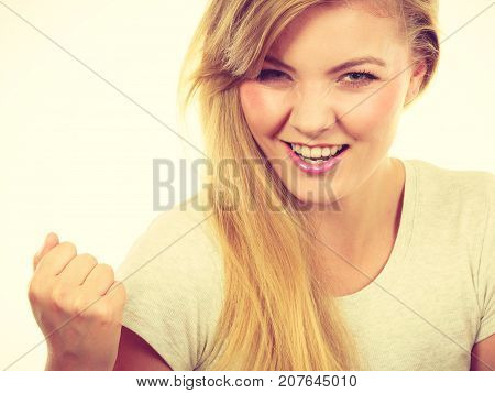 Happy Positive Blonde Woman Clenching Fists