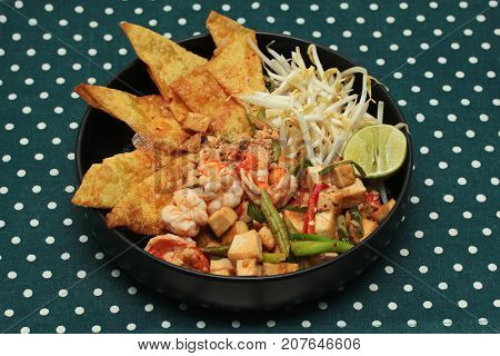 Popular Thai recipePad Thai with prawn and crisy wonton bean sprouts topped halve lemon call Pad Tai Keaw Krob Kung Sod in Thai poster