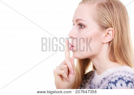 Young Blonde Woman Making Silence Gesture