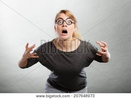 Psychology frustration emotions feelings concept. Furious woman yelling. Nedry girl angered frustrated screaming out of wrath.