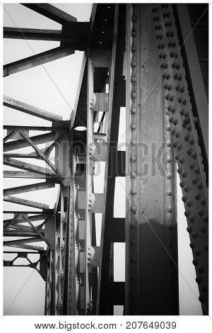 Iron bridge supports with rivets close-up retro style poster