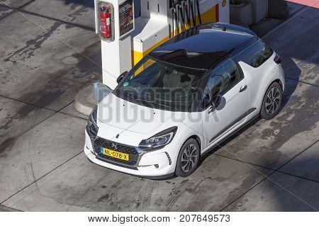 Frankfurt Germany - Sep 19 2017: White Citroen DS3 with a black roof on the petrol station in Germany
